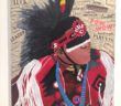 Acrylic portrait of male powwow dancer surrounded by clippings of words from magazines
