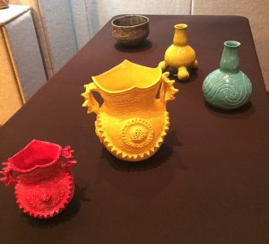Five Caddo designed pots in bright yellow, red, turquoise, and purple