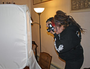 Artist photographing work